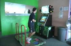 Chris plays Dance Dance Revolution (DDR) at Golden Token Amusement